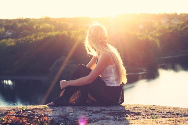 woman-rock-sunset